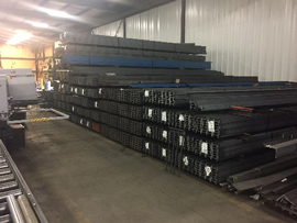 lots of stacked steel beams